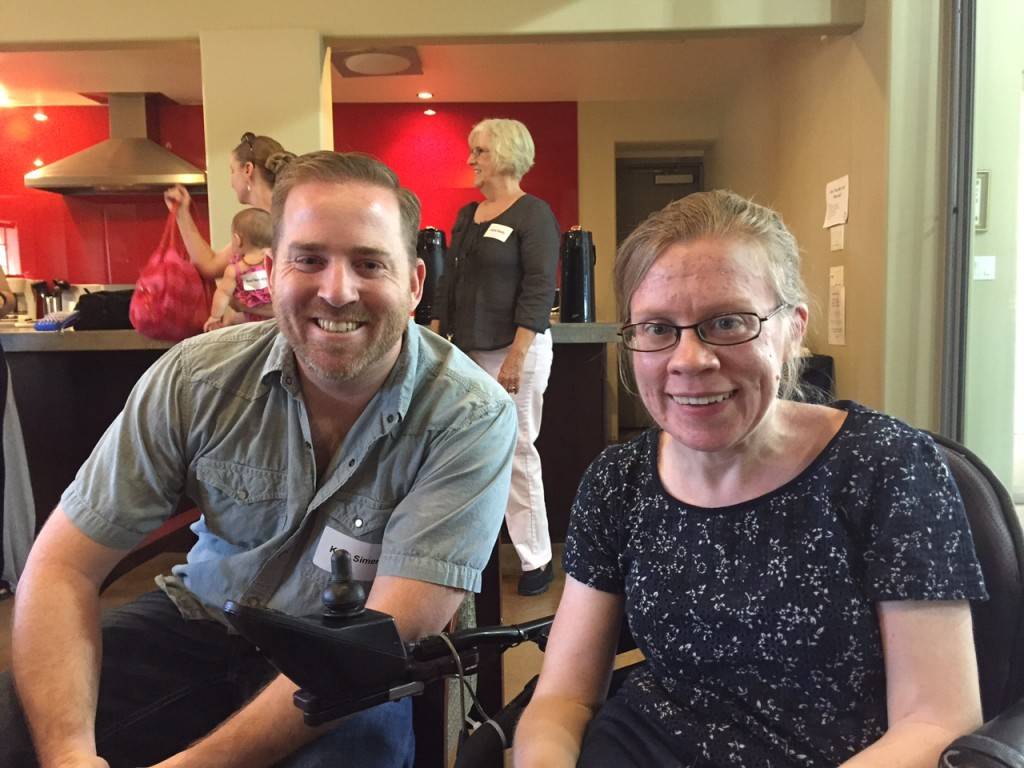 Kent Simer (left) poses with Kara Kahnke. (right)